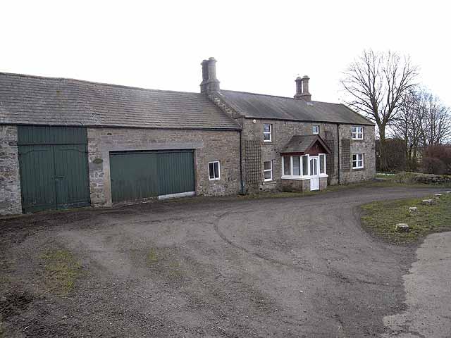 Roadside house and barn at Little Bavington