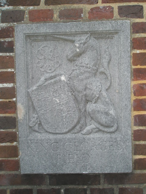 Commemorative stone on the right pillar at the entrance to King George V Playing Fields