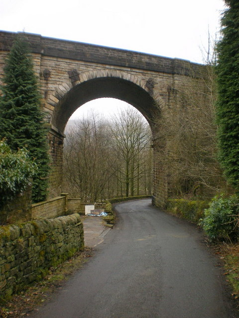 Den Lane as it passes under Uppermill Viaduct