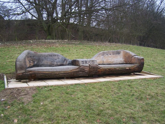 Carved Bench on hill in farm