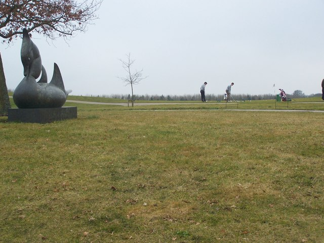 Duck Sculpture and Golfers Driving Range