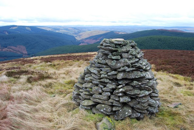 Cairn near summit of Scawd Law with view down Wamphray to Solway