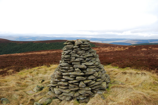 Scawd Fell cairn looking across ridge to Wintergill Head with Lowther Hills in distance
