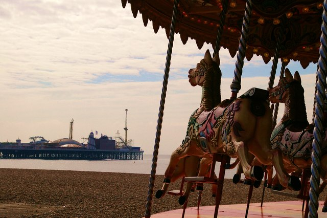 Brighton Pier behind the carousel