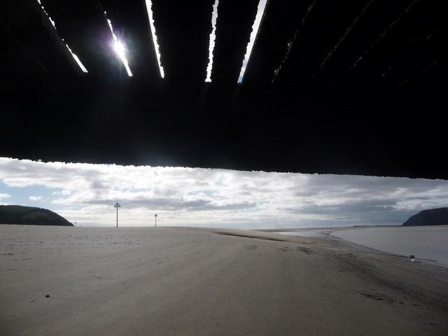 Ferryside: view under a jetty