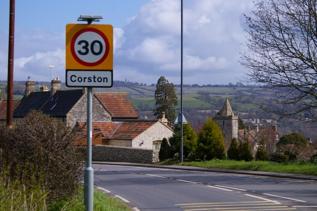 Corston village sign with the church behind