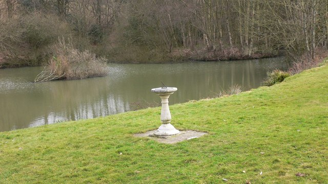 Sundial and village pond at Hascombe