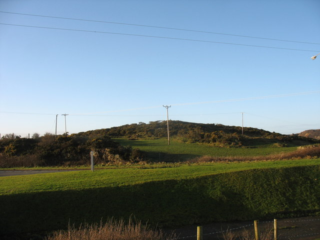 The A5025 and the gorse covered Yr Hald hill from the Pensarn War Memorial