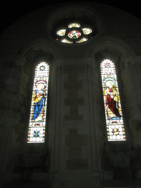 Stained glass windows above the altar at Holy Trinity, Privett