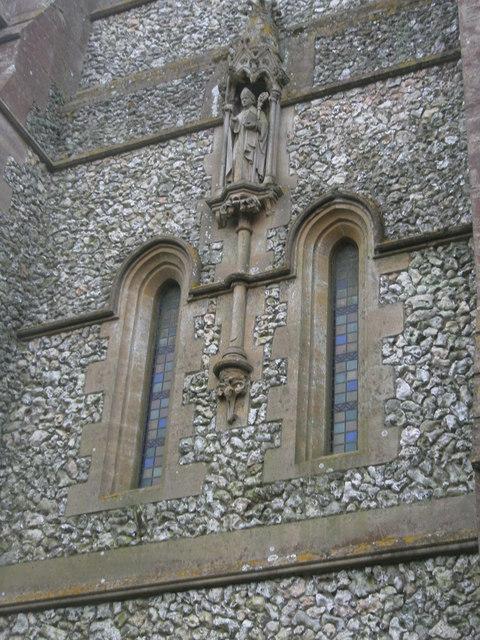 Statue on the wall of Holy Trinity, Privett