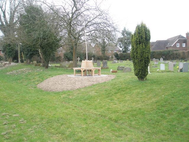 Circular seat in Ropley Churchyard