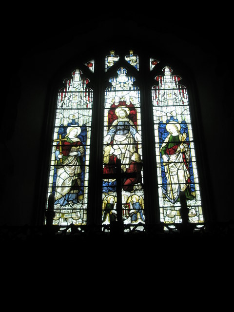 Stained glass windows above the altar at St Peter's, Ropley