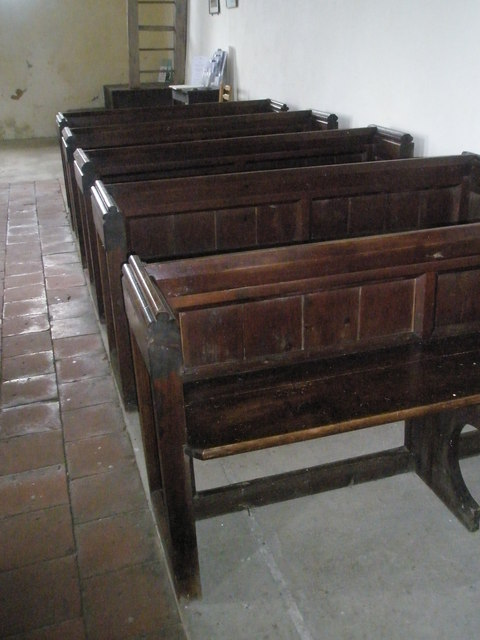 Ancient pews within St Peter ad Vincula, Colemore