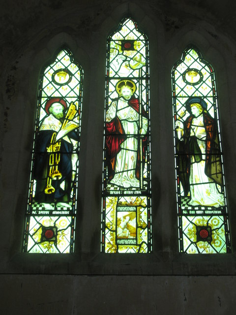 Stained glass windows above the altar at St Peter ad Vincula, Colemore