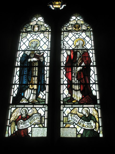 Detailed stained glass window on the north wall at St Peter's, High Cross