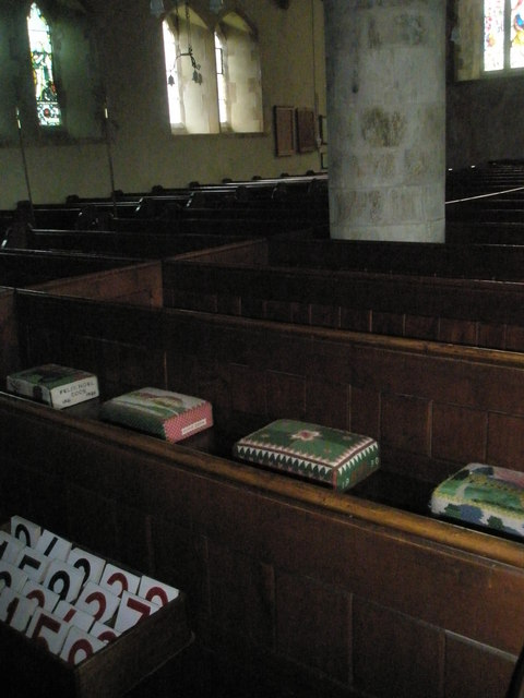 Kneelers and pews within St Peter's, High Cross