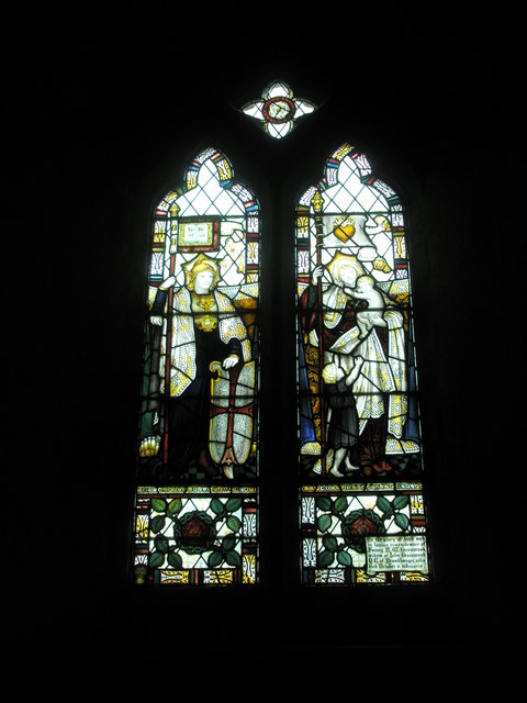 Intricate stained glass window on the north wall at St Peter's, High Cross
