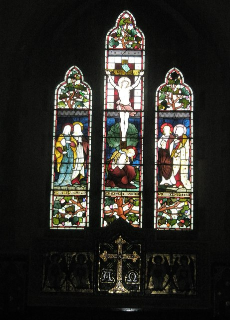 Stained glass windows above the altar at St Peter's, High Cross