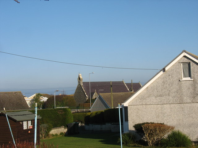 View across gardens towards St Patrick's Church, Cemaes