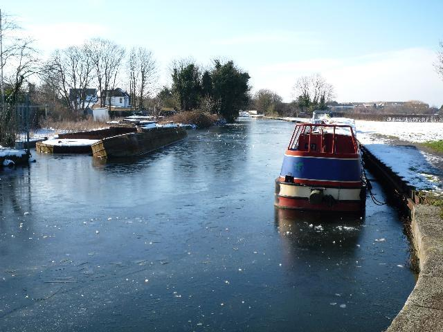 A frozen Grand Union Canal near to the Three Bridges