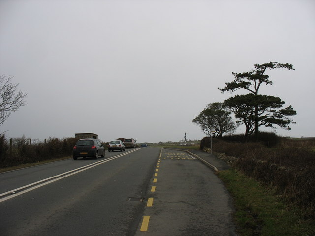 The southbound bus stop on the A5025 at Llaneuddog