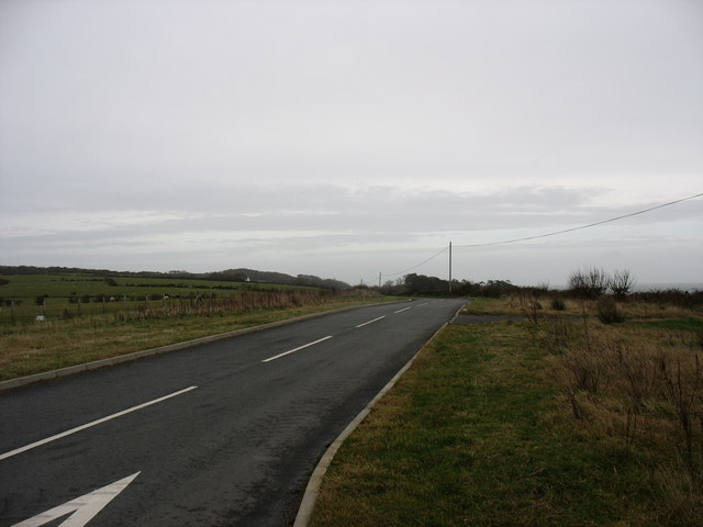 The new section of the Cochwillan road near its junction with the A5025