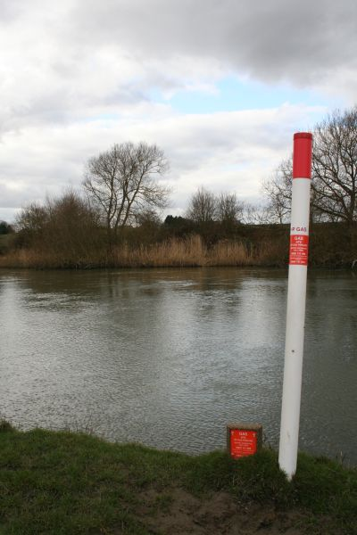 Marker post by  the river