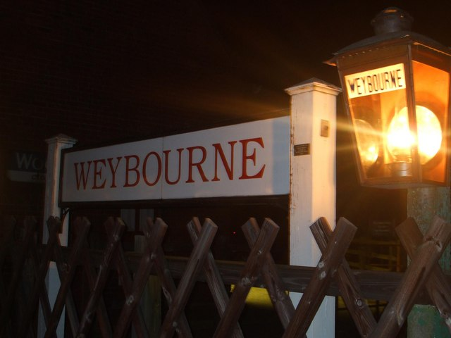 Weybourne station sign at Night