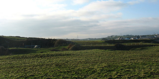 View west towards the disused limestone workings at Penrhyn Mawr