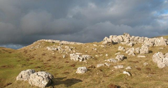 Pale limestone, dark clouds