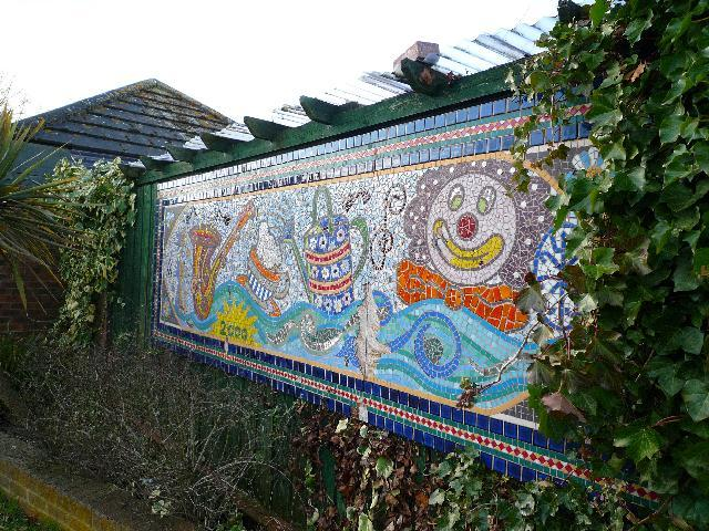 Mosaic near to the canal entrance of the Willowtree Marina