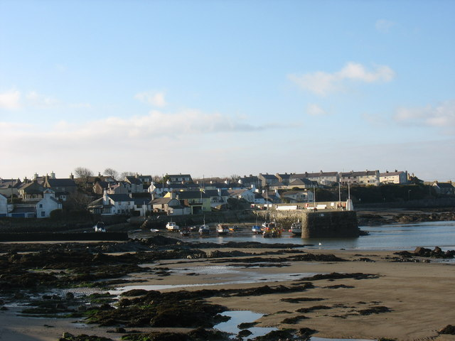 View across the sands towards Cemaes Harbour