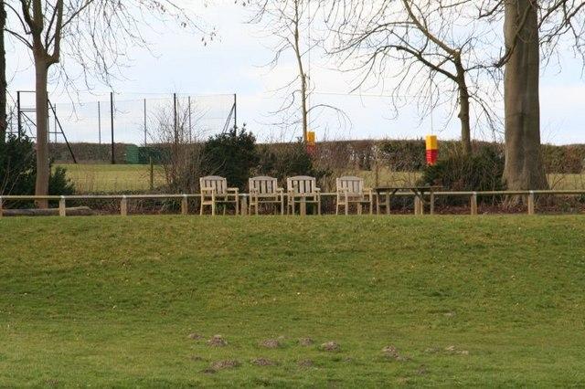 Empty seats by the school