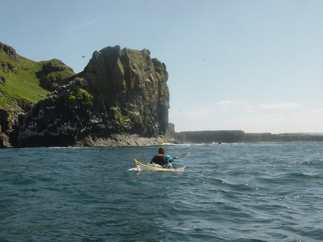 Kayaking south down the west coast of Lunga in a swell