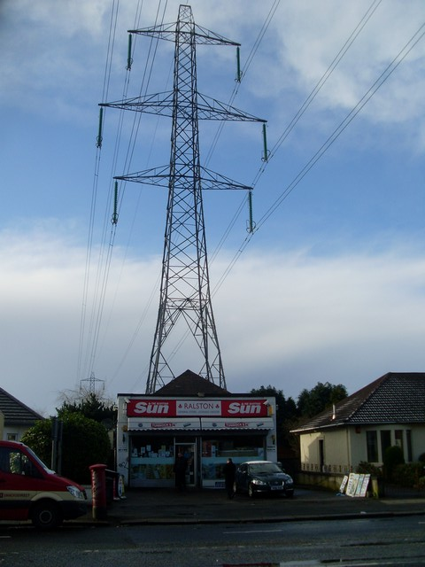 Newsagent overshadowed by pylon