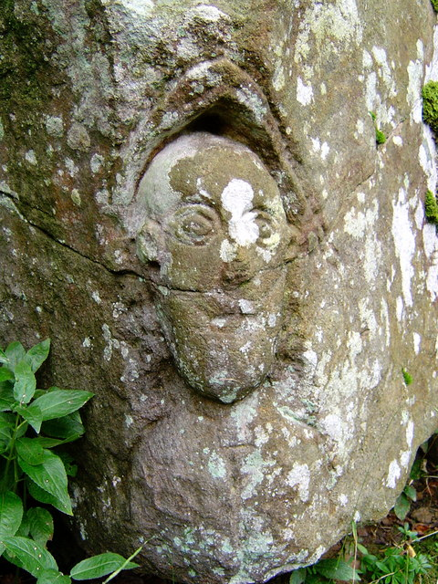 Carved face by path in Deepdale