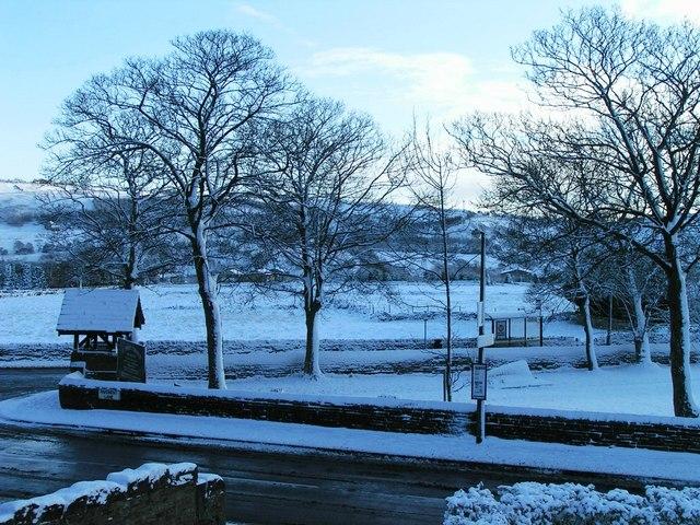 Lych Gate and Churchyard of St John the Evangelist Church, Bradshaw, in Snow