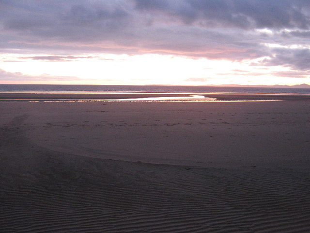 The evening light reveals beach features