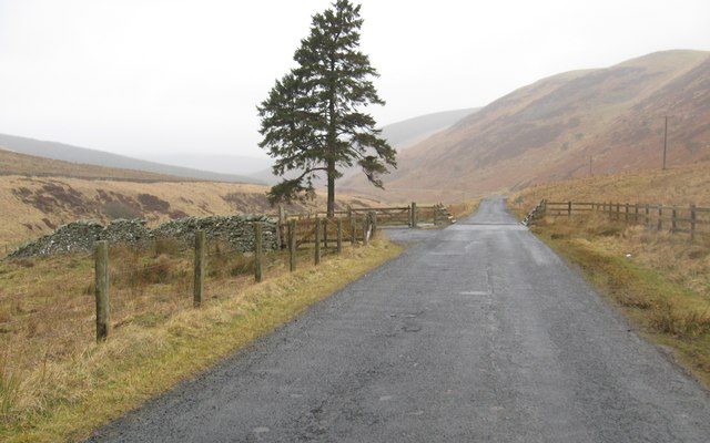 The minor road heads in to wild country in the Borders