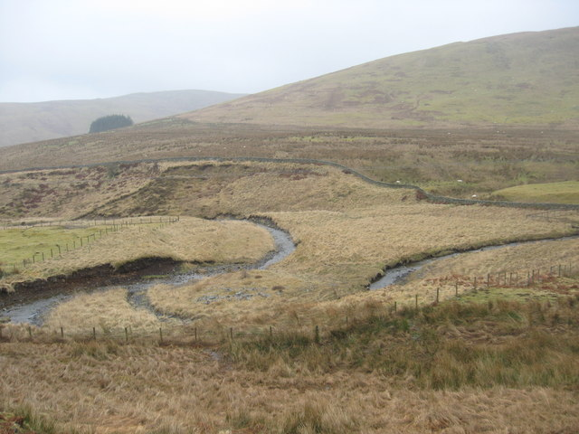 The Tushielaw Burn meanders through rough grazing land