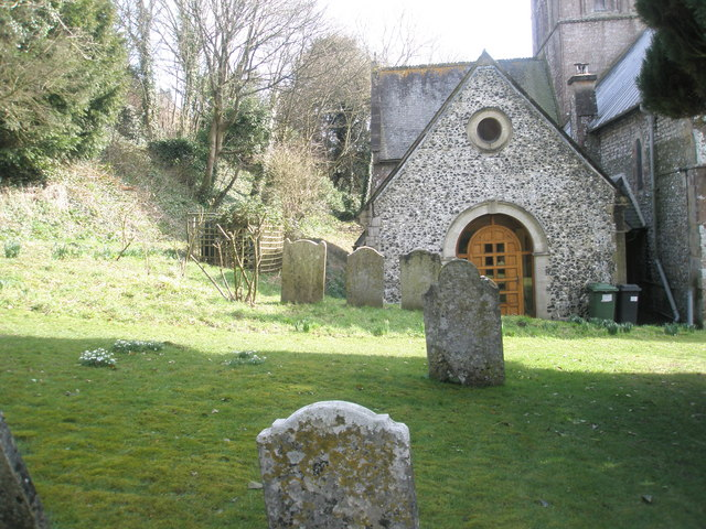 Gravestones in the churchyard at All Saints, East Meon