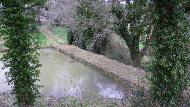 Footpath causeway above pond