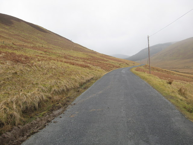 Looking back on the B709 passing Altrieve Farm