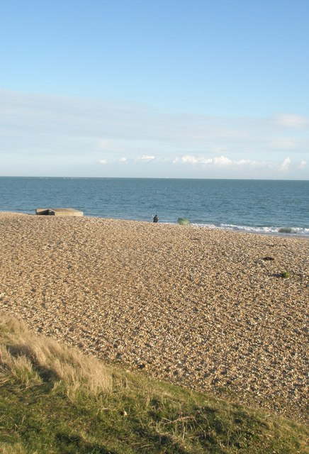 Distant fisherman on Eastney Beach