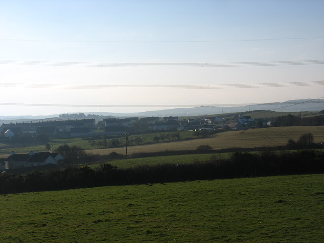 View across farmland towards the village of Tregele