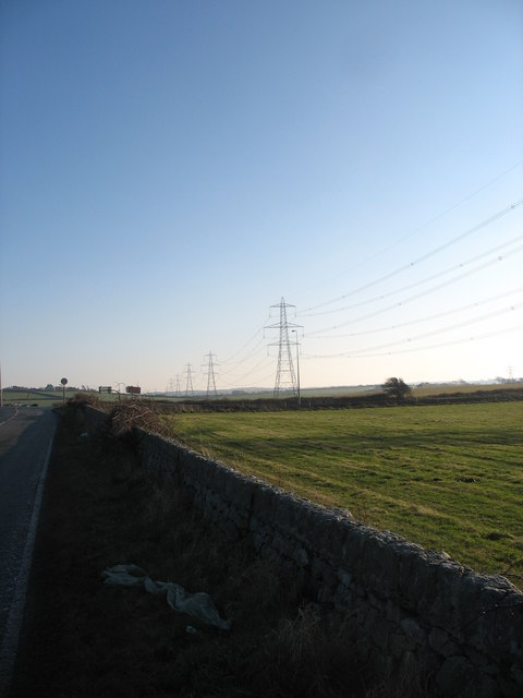 Powerlines leading southwards towards the mainland