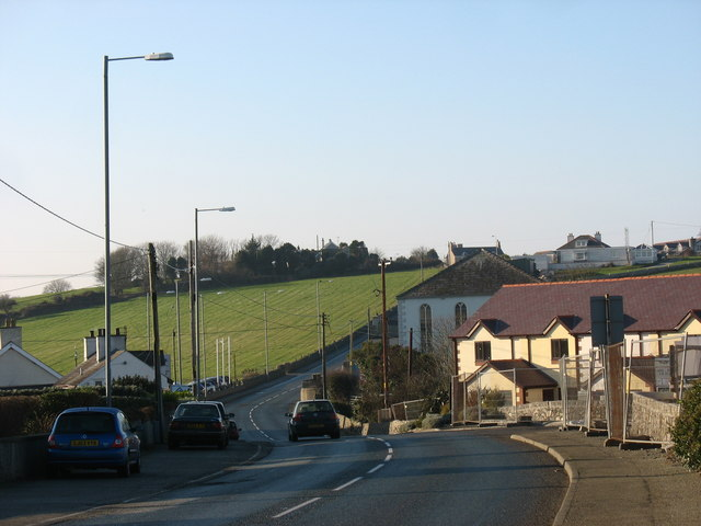 View west along the A5025 towards Maes y Capel Estate and Capel Bethesda