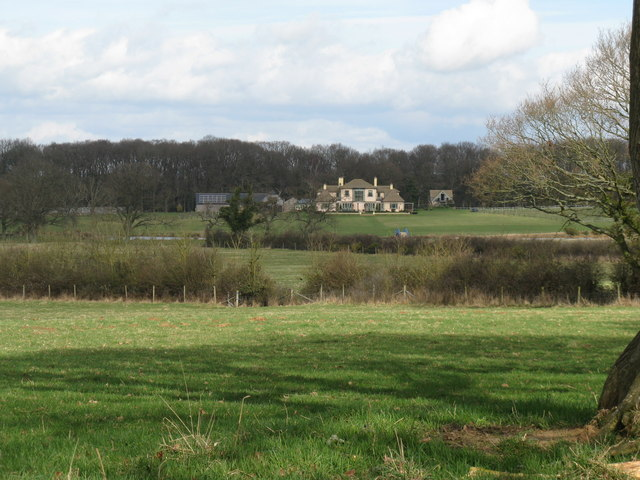 View across fields to unnamed and unmarked house
