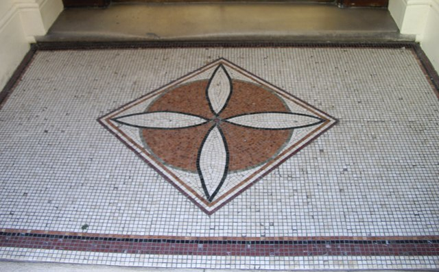 Mosaic at entrance to Carlisle Mansions