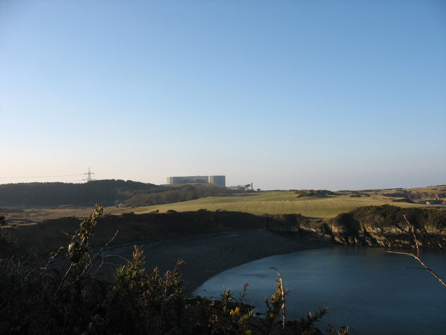The head of Porth yr Wylfa cove with the Wylfa NP Station in the background